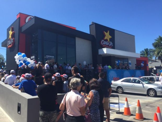 Aussies line up for the opening of the first Carl's Jr. restaurant in Bateau Bay.