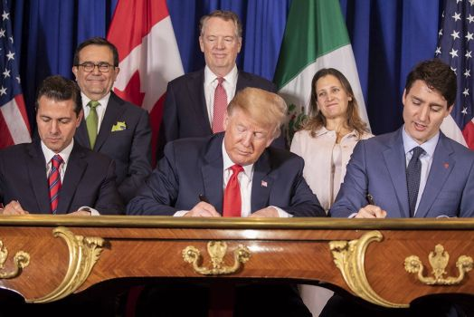 US President Donald Trump, center, Canadian Prime Minister Justin Trudeau, right, and Mexican President Enrique Pena Neto, left, during a signing ceremony for the new NAFTA trade agreement called USMCA November 30, 2018 in Buenos Aires